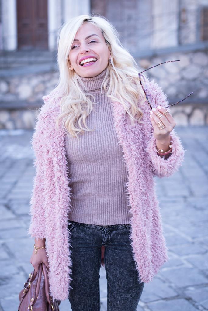 Happy in a pink faux fur coat